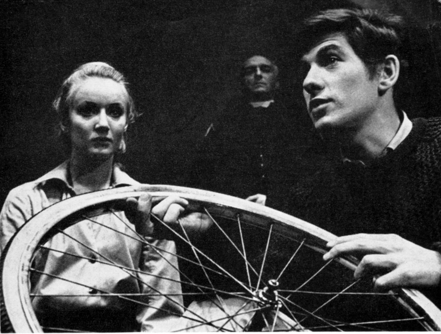 Jennifer Hilary as Zoe watches unseeingly as her stepbrother Godfrey (Ian McKellen) mends a puncture. In the background, the Priest is played by Peter Howell<br><em> </em>