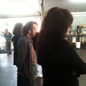 A moment of silence for Christchurch earthquake victims, in the food tent at Stone Street Studios, 7 March 2011