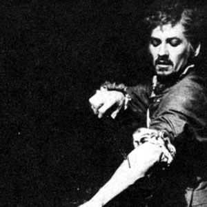 Mephistophiles (Emrys James) onbserves as Dr Faustus (Ian McKellen) inflicts the fatal self-inflicted wounding which commits Faustus's      soul