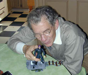 With Magneto action figure