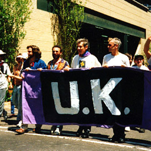 1994,   South Africa Gay Pride; the UK contingent: Greg Doran, Antony Sher, Ian McKellen, Sean Mathias, Johannesburg (home made banner by Tony Sher & Ian)