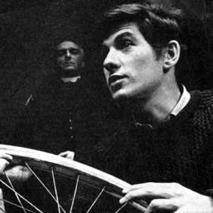 1964, A SCENT OF FLOWERS: Jennifer Hilary as Zoe watches unseeingly as her stepbrother Godfrey (Ian McKellen) mends a puncture. In the background, the Priest is played by Peter Howell