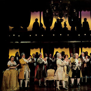 Nicholas Kepros (centre; Emperor Joseph II) welcomes Tim Curry (Mozart) to court. Ian McKellen (Salieri) applauds stage right.