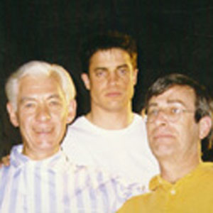 1997, GODS AND MONSTERS: Ian McKellen (Whale), Brendan Fraser (Clay), and Christopher Bram (author of novel Father of Frankenstein) on set at Occidental Studios, Los Angeles.