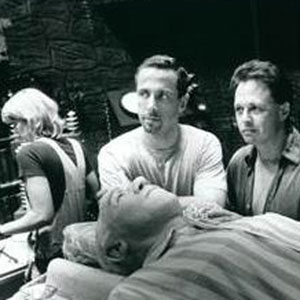 1997, GODS AND MONSTERS: Executive Producer Clive Barker with Director Bill Condon on the dream sequence set.