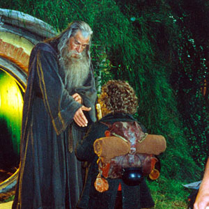 Gandalf bids farewell to Bilbo outside the door at Bag End