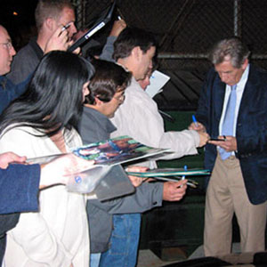 Signing autographs on the way out of the Canon Theater, 4 March 2002