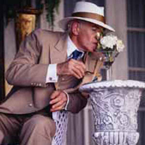 1997, GODS AND MONSTERS: James Whale (Ian McKellen) smells the flowers at George Cukors garden party