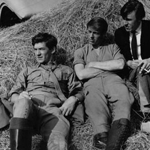 1966, THE BELLS OF HELL GO TING-A-LING-A-LING: L to R: Ian McKellen, Burris de Benning, David Baxter <BR><BR><em>The glamorous Burris de Benning was from the States.  I was closer to my countryman David Baxter, who was having a mournful summer. At birth he was a blue baby and before multiple blood transfusions, had been given only 20 or so years to live.  Then in his 20's, he often mused on life's vagaries.  He and I shared our free time up and down the slopes of Gstaad and were equally relieved when the unit photographer gave us the news that the film was to be cancelled.</em>  - Photo by Al Parker