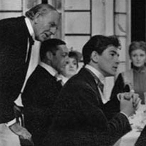 1961, YOU NEVER CAN TELL: L to R: Allan Jeayes, John Scarborough, Bridget Turner, Ian McKellen, Sheila Keith, Ronald Magill. <BR><BR><em>The regular company was joined by Allan Jeayes (Walter, the waiter), a distinguished veteran from Alexander Korda's romantic British films.  Being nearly 80, he had trouble remembering his lines, although in this scene he singlehandedly served a four-course meal in under 15 minutes! </em>