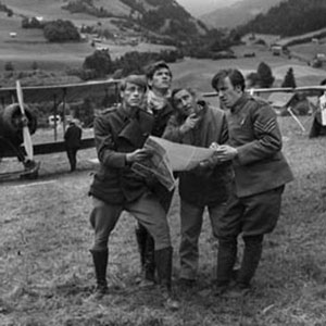 1966, THE BELLS OF HELL GO TING-A-LING-A-LING: Gregory Peck with his young team of aircraftsmen planning to carry Allied aeroplane parts through occupied territory where they would be reassembled in order to bomb enemy targets. <BR><BR><em>Peck kept himself privately in his caravan between shots, where he read and answered his mail.  He told me about his early days in theatre, where he had been happy just to sweep the stage.  He was now a huge movie star.  In our film he was not well-cast as an English army Colonel &#151; he repeatedly addressed me as Loo-tenant: and when I repeatedly corrected his pronunciation (in UK we say Left-tenant), the director David Miller told me to shut up. Never forget Ian, Great Britain is only 5% of the world market.</em>