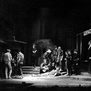 1958, CAMINO REAL: Garry O'Connor plays the guitar, Ian McKellen dies, tall Simon Relph watches and Richard Cottrell, sitting, plays out front in Camino Real, ADC 1958  - Photo by Edward Leigh