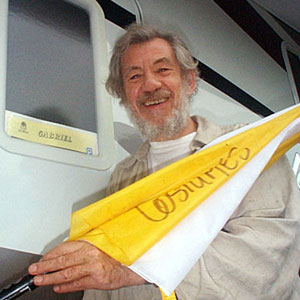 Ian McKellen (Gabriel) outside his dressing room trailer with a purloined umbrella, Vancouver, October