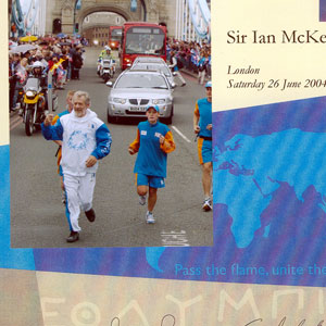 Carrying the torch across Tower Bridge, 26 June 2004