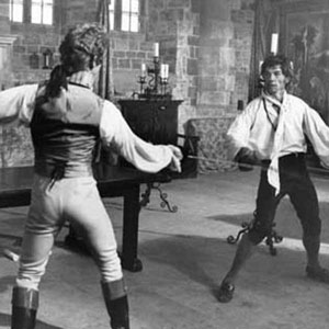 The Pimpernel (Anthony Andrews) on his way to defeating Chauvelin (Ian McKellen) with foils (action director Peter Diamond.)