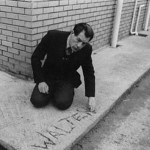 His adventures over, Walter (Ian McKellen) immortalises his name in the fresh concrete path round his hospital quarters.