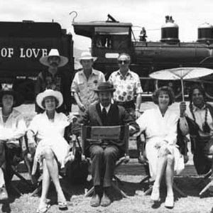 L to R: Marizio Meru, Penelope Keith, Janet Suzman, Stanley Seger, Christopher Miles, Ian McKellen, Andrew Donnally, Ava Gardner, Jorge Riveras <BR><BR><em>The steam-train had been brought out of retirement and, for this publicity shot, re-named</em>