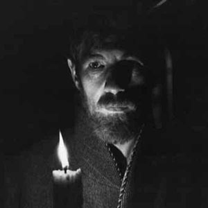 Lawrence (Ian McKellen) off to bed <BR><BR><I>This scene showed me candlelit moving round the marital bed � in shadow I displayed the first erection ever seen in a mainstream movie.  This was achieved with a dildo and a great deal of sticking-plaster.</I>