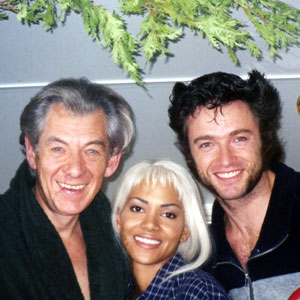 Ian McKellen (Magneto), Halle Berry (Storm), and Hugh Jackman (Wolverine) take a Christmassy break in the makeup trailer, Toronto