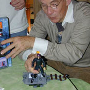 Playing with Magneto action figure