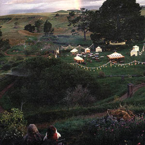 Ian McKellen as Gandalf and Ian Holm as Bilbo oversee party preparations in Hobbiton